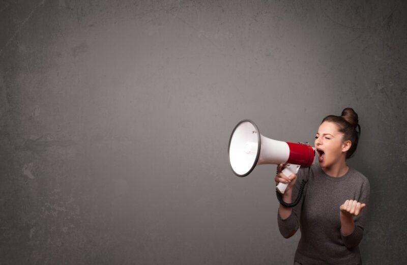 Calls to action from woman with megaphone.