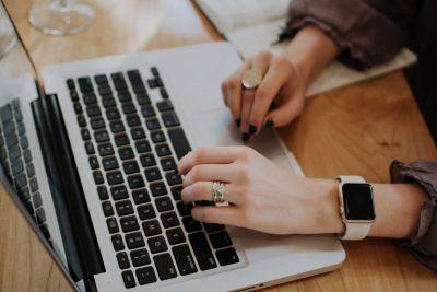 Business blog posts written on a laptop