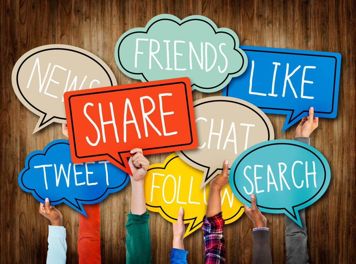 34537384 - hands holding speech bubbles with social media words