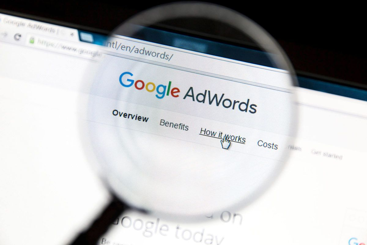 57066618 - google adwords website under a magnifying glass. google adwords is an online advertising service.