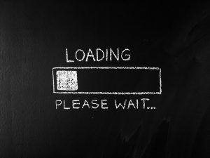 Loading Please Wait Written on Blackboard