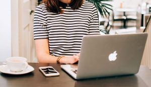 Woman in Black and White TShirt Using Free SEO Audit Tool On Laptop