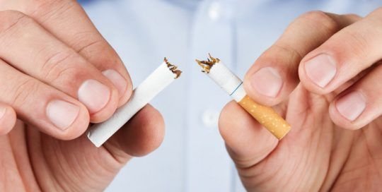 Quit smoking, human hands breaking up cigaretteQuit smoking, human hands breaking up cigarette
