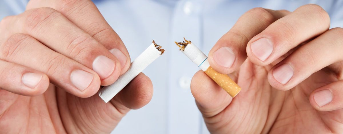 Quit smoking, human hands breaking up cigaretteQuit smoking, human hands breaking up cigarette
