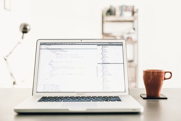 Computer showing web development coding.
