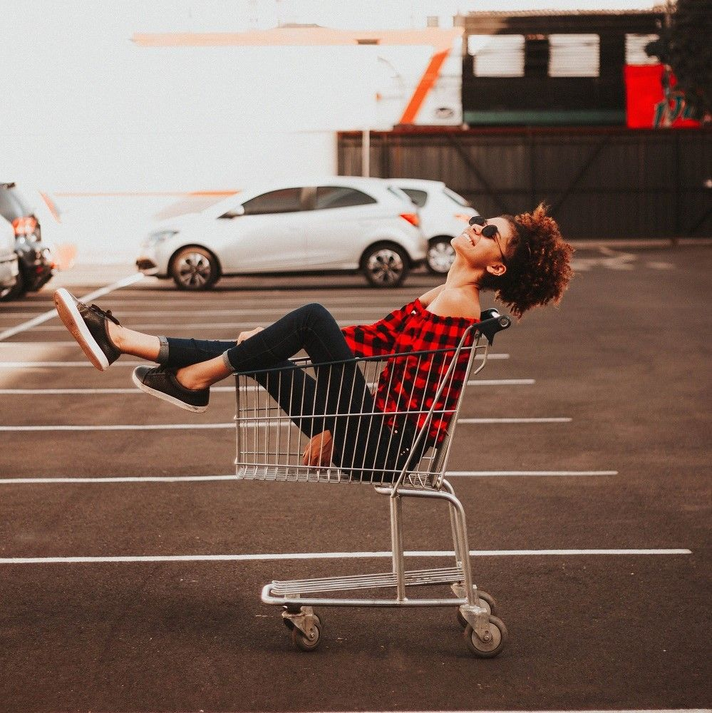 woman in a trolley after shopping online.