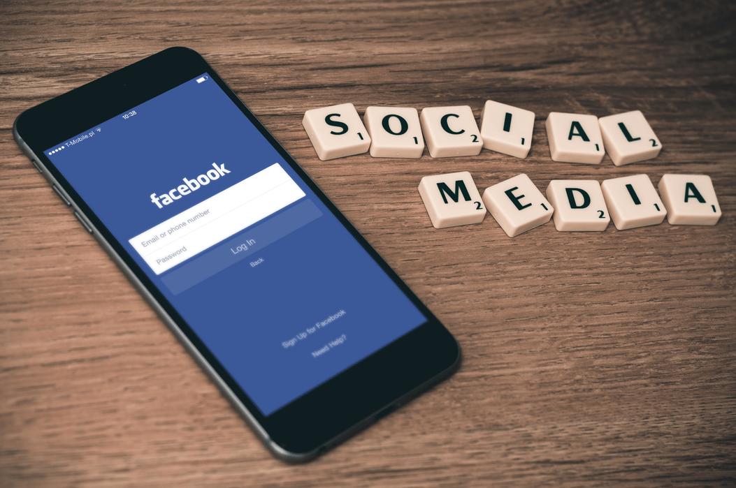 Social Meida Profiles: Mobile Phone Screen Showing Facebook App