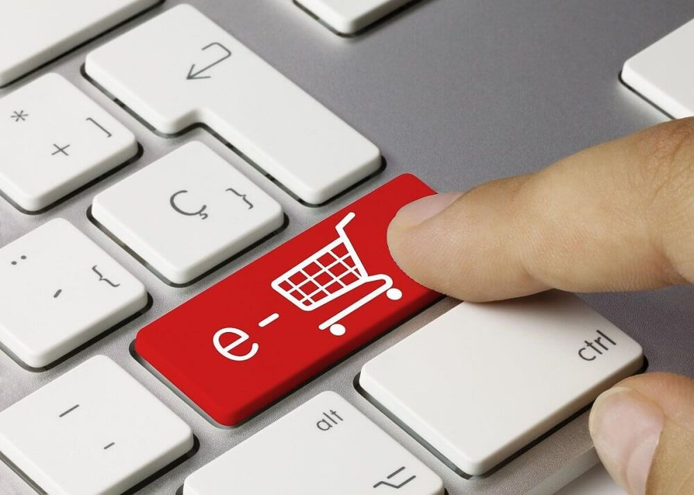 Man pressing a button to order ecommerce marketing services.