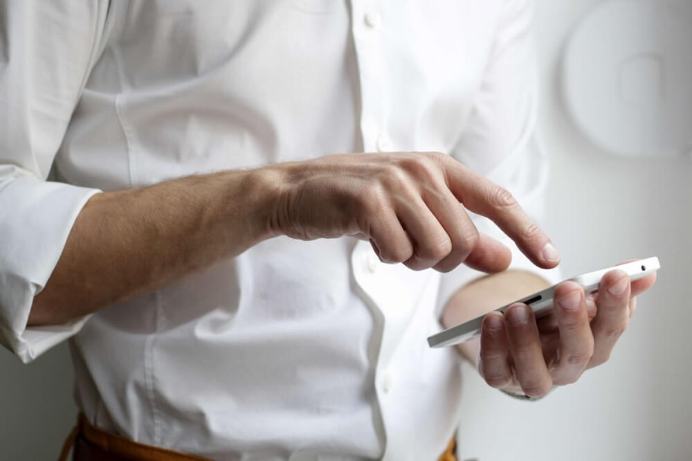 Man setting up email marketing for business prospects.