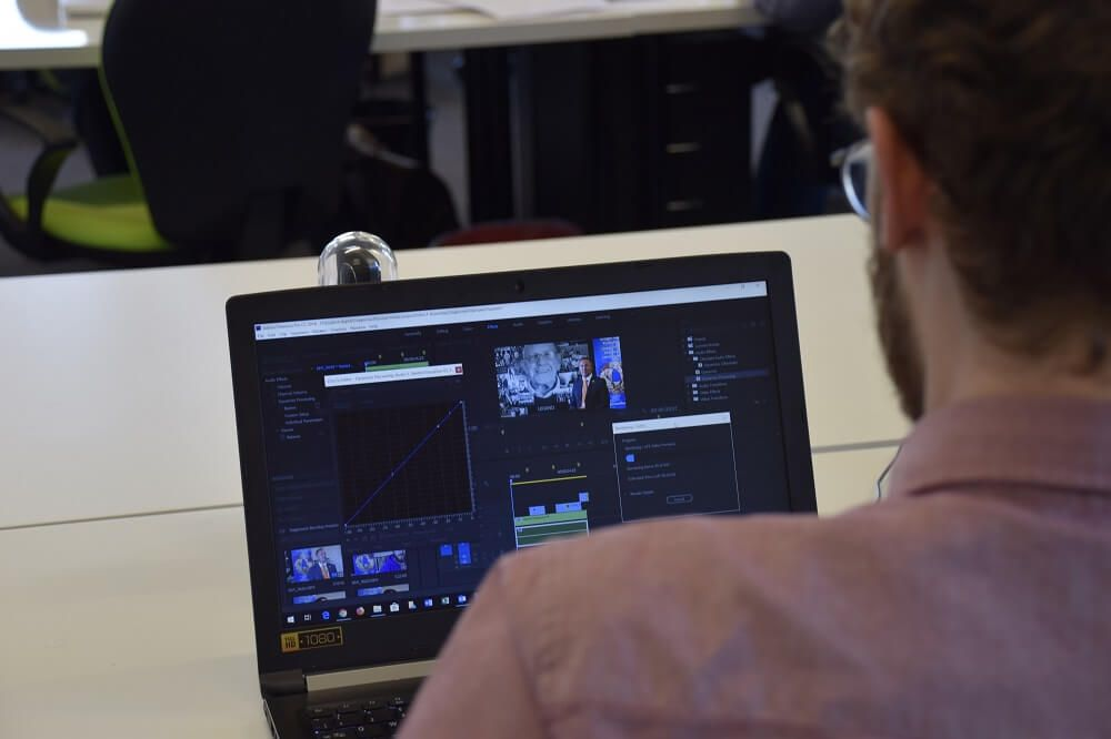 Video production services on a laptop screen.
