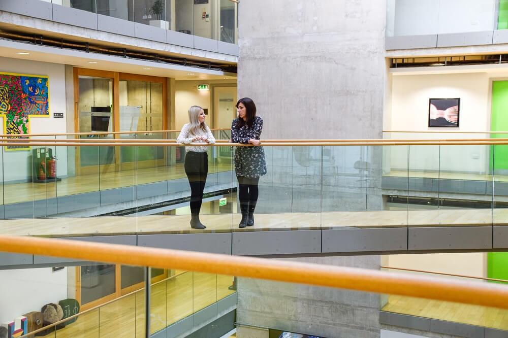 web design huddersfield staff talking in building