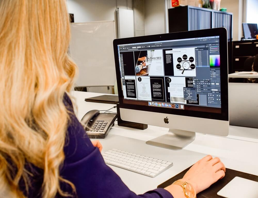 website design manchester designer working on computer screen